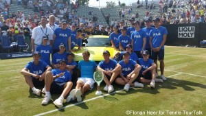 Rafael Nadal with the ballkids in front of his new Mercedes
